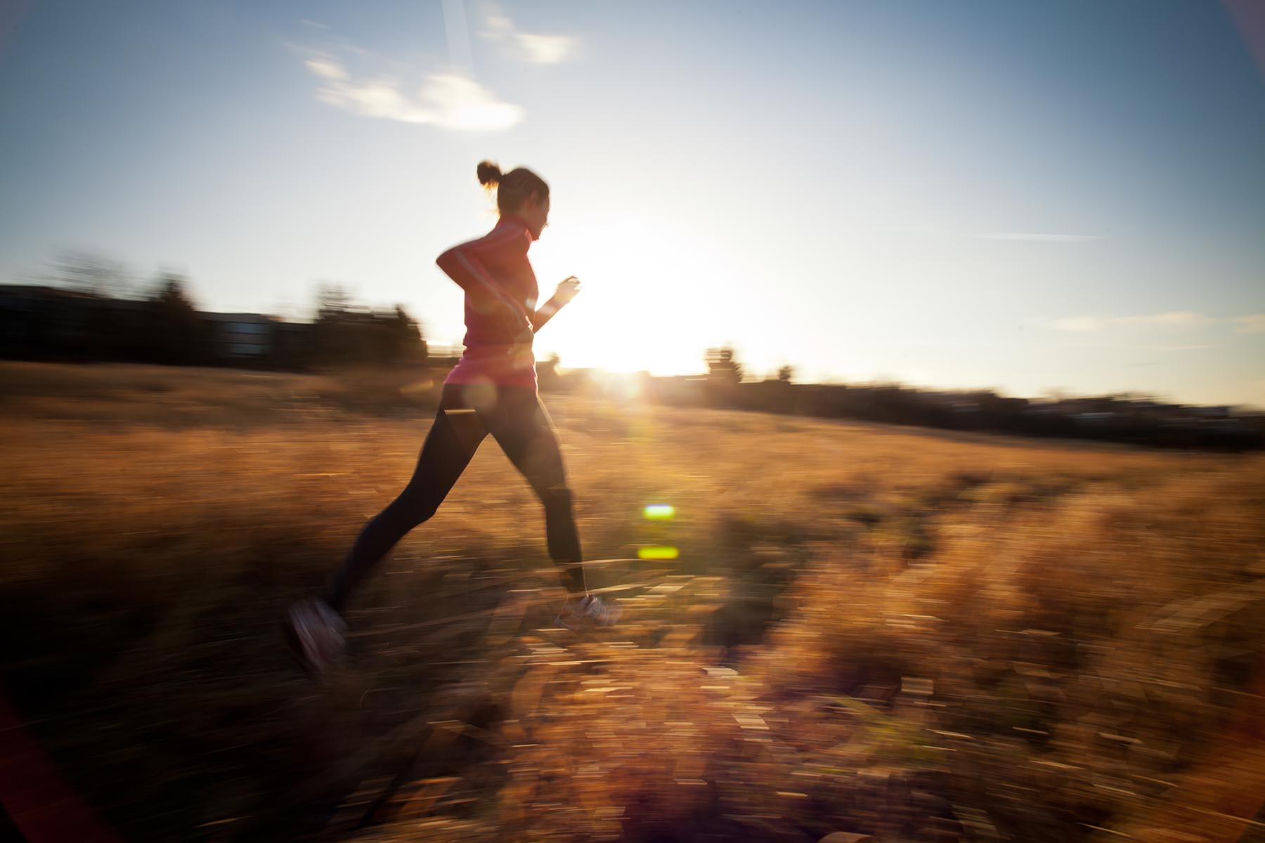 Young Woman Running Outdoors On A Lovely Sunny Winter/fall Day (