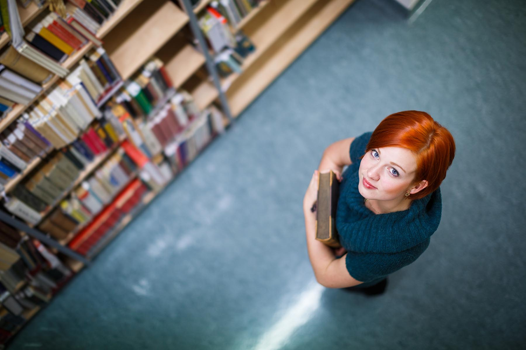 Pretty, Female College Student In A Library, Looking For A Book