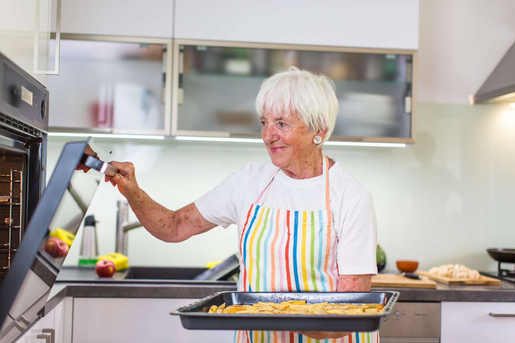 Senior Woman Cooking In The Kitchen   Eating And Cooking Healthy